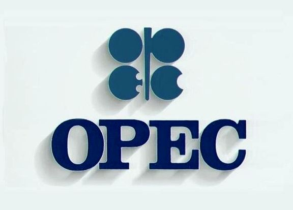 OPEC cuts oil demand forecasts, warns of supply glut.